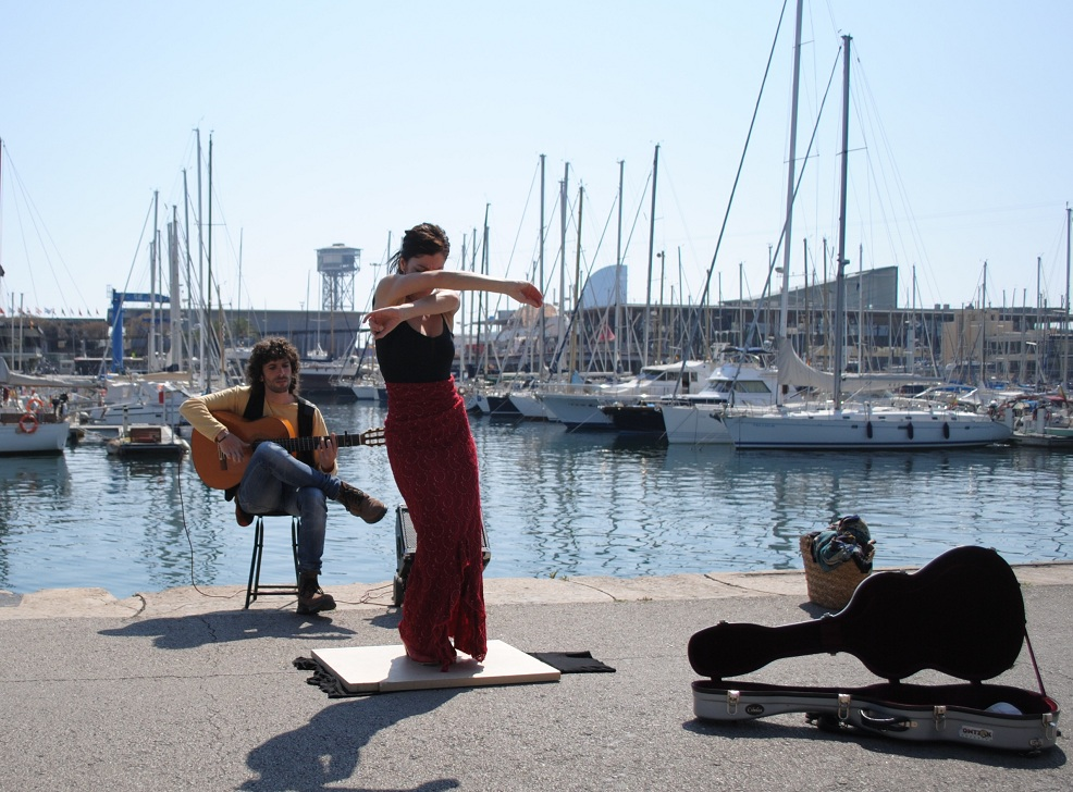 Flamenco dancer in front of Port Vell, Barcelona